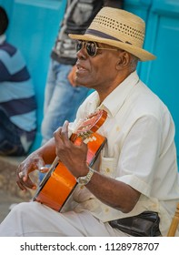 HAVANA - CUBA APRIL 2017- STREET MUSICIAN PLAYS GUITAR FOR NEWLY