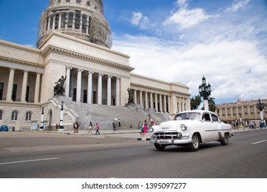 Havana, Havana / Cuba - April 21st 2019: Classic American car driving past Capitolio.