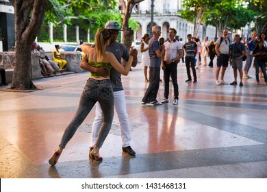 Havana, Havana / Cuba – April 21st 2019: Couple dancing in the streets of Paseo del Prado.