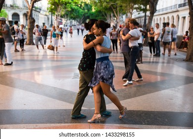 Havana, Havana / Cuba – April 21st 2019: Dancing couple on  Paseo del Prado.