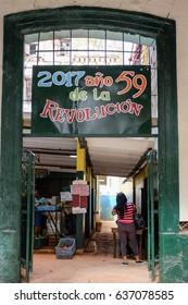 HAVANA, CUBA - APRIL 27, 2017: Grocery shop with a propaganda manifesto in Old Havana, a historic neighborhood under restoration.