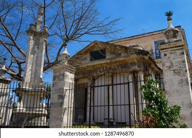 Havana, Cuba - April 5, 2014: Front of El Templete neoclassical monument to the founding of Havana Cuba with Virgin of Pilar column