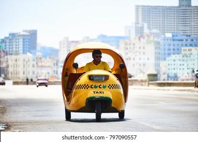 Havana, Cuba - AUG 6, 2017: An italian Vespa scooter tranformed in a taxi it's very typical in Havana, Capital of Cuba.