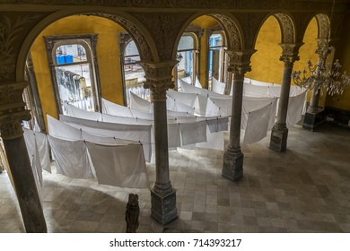 HAVANA, CUBA - AUGUST 14, 2017: Havana's popular  La Guarida Restaurant features a a grand staircase and a downstairs foyer used to used to dry table cloths. The name La Guarida means the Hideout.