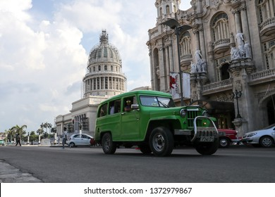 Havana, Cuba - August 2, 2017.  Vehicle driving in from of the capital building in Havana, Cuba.