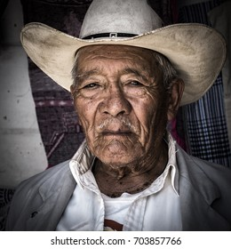 HAVANA, CUBA - AUGUST 9, 2017: A Mexican farmer poses at a stall near Mexico city. Despite fears of drug crime violence, Mexico remains one of the world's most popular visitor destinations.