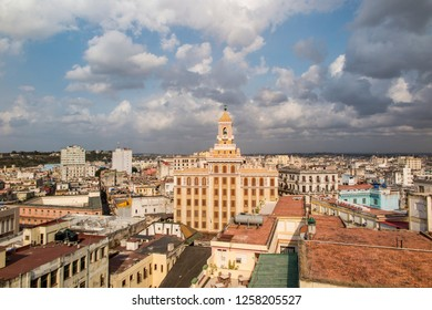 Havana, Cuba - c.May 2015: Classic skyline cityscape looking out over the old town towards the 12-storey Art Deco 'Bacardi' building. Architecture of the era depicted by bold angles and lines.