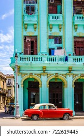 HAVANA, CUBA, CIRCA APRIL 2017: Typical street of Havana, Cuba, with parked american classic car. With its shabby atmosphere, Havana is the destination of more than 1 million tourists every year