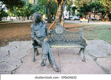 HAVANA, CUBA - CIRCA DECEMBER 2016: The statue of John Lennon sitting on a bench in John Lennon Park, Vedado neighbourhood, Havana, Cuba.