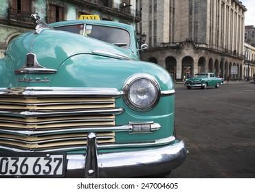 HAVANA, CUBA - CIRCA JANUARY 2014: 1940s Dodge Sedan taxi circa January 2014 in Havana. An estimated 60,000 US automobiles from the pre-embargo age are still running  in Cuba