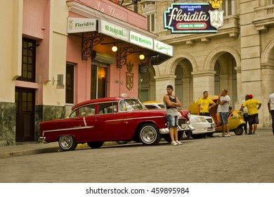HAVANA, CUBA - CIRCA JULY 2016: Late afternoon along a historic street in Havana, Cuba with famous cafe and classic old American car.