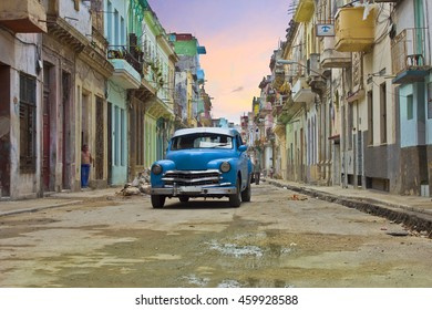 HAVANA, CUBA - CIRCA JULY 2016: Afternoon along a historic street in Havana, Cuba with classic old American car.