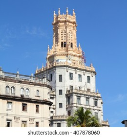 Havana, Cuba - city architecture. Eclectic buildings and palm trees.