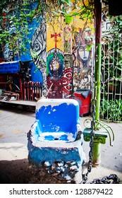 HAVANA, CUBA - DEC 30: graffiti on Callejon de Hamel alley on December 30 2012 in Havana, Cuba. Callejon de Hamel is considered a public temple to Santeria religion and afrocuban culture.