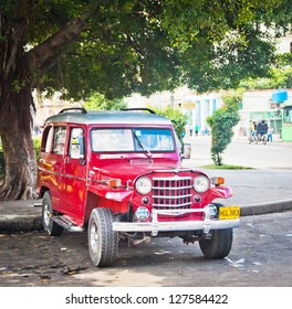 HAVANA, CUBA - DEC 30: Old classic 1950 Willys on December 30, 2012 in Havana, Cuba. With an estimated 60,000 vintage cars still in Cuba, these old classics are a tribute to the nostalgia of the old days.