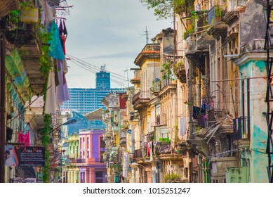 HAVANA, CUBA - DEC 4, 2015: Urban scene with colorful colonial buildings on a sunny day in Old Havana street