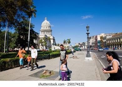 Havana, Cuba - December 10, 2012 : A street scene with pedestrians and traffic in Havana at the Capitolio in Cuba