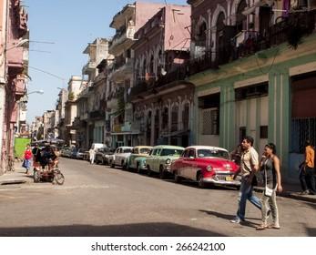 HAVANA, CUBA - DECEMBER 10, 2012: Unidentified people on the street of Havana, Cuba. Havana is the capital city, province, major port, and leading commercial centre of Cuba.