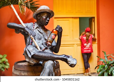 Havana, Cuba - December 12, 2016: Rom themed statue in the inner courtyard of the Museo del Ron (Rum Museum) in Havana