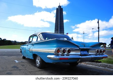 HAVANA, CUBA - DECEMBER 15 2014: Historic buildings of the Cuban revolution with an old car from the 1950´s