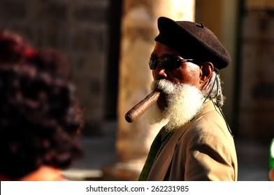 HAVANA, CUBA - DECEMBER 15 2014: Cuban unidentified person smoking a cigar in the center of Havana. USA has announced changes to its policy with Cuba