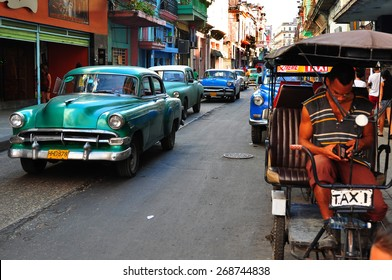 HAVANA, CUBA - DECEMBER 15 2014: A bicicle taxi driver in the center of Havana, after the US announced changes to its policy with Cuba