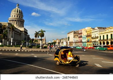 HAVANA, CUBA - DECEMBER 15 2014: Moto taxi in the center of Havana with the Capitolio as background. The US has announced changes to its policy with Cuba