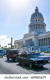 Havana, Cuba - December 19, 2016: Retro cars pass the Capitol building (El Capitolio) in the heart of Habana Vieja (Old Havana) in Cuba
