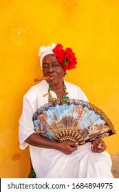 HAVANA, CUBA - DECEMBER 2, 2005: Cuban woman smoking a big cigar