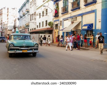 HAVANA, CUBA - DECEMBER 2, 2012: Oldtimer car on the street of Havana, Cuba. It is estimated that there are some 173,000 cars in Cuba  and 60.000 of them are classic cars called Yank Tank.