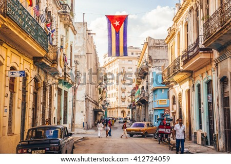 Havana, Cuba in December 2015: A cuban flag with holes waves over a street in Central Havana. La Habana, as the locals call it, is the capital city of Cuba