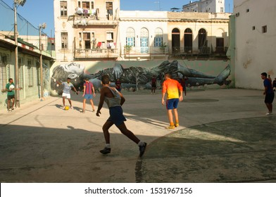 Havana, Cuba - December 2016: A group of boys playing soccer on an indoor square.
