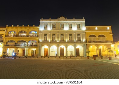 Havana, Cuba - December 25, 2017: Buildings around the Old Square in the historic area of Havana. This colonial quarter is popular with visitors from all over the world.