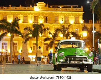 Havana, Cuba - December 25, 2017: A classic American car is parked in front of the famous Inglaterra Hotel in the center of Havana.
