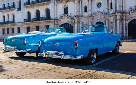 Havana Cuba, December 27, 2017: Two bright blue American made convertible classic cars parked in Old Havana