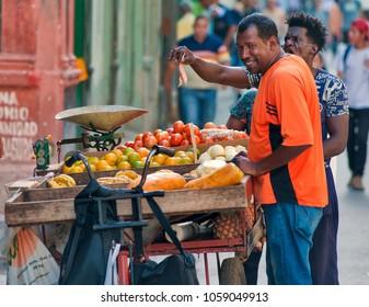 HAVANA, CUBA- FEB 12, 2018: wandering fruit seller in the streets of Havana in Cuba