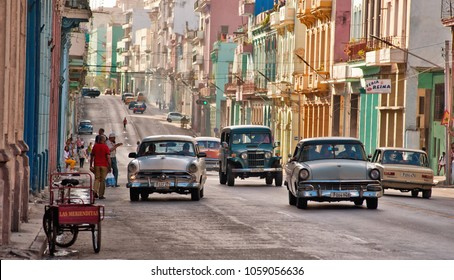 HAVANA, CUBA- FEB 12, 2018: old cars transiting in an avenue of Havana, Cuba