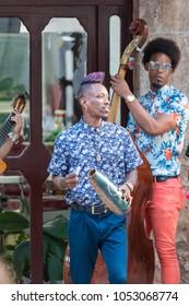 Havana, Cuba, Feb .13.2018:  Buskers playing typical Cuban Latin music in a public street of Old Havana.