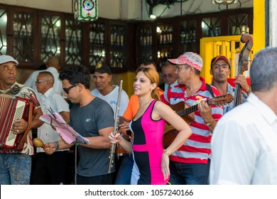 Havana, Cuba, Feb .13.2018: Musicians playing typical Latin music at a open bar in Old Havana.