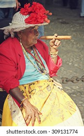 HAVANA, CUBA - FEB 16: An old lady is smoking a big cigar on the street in Havana, Cuba on February 16 2008.
