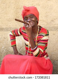 HAVANA, CUBA -FEBR 8; Unidentified woman with a cigar on februari 8, 2013 in Havana. The african culture  has a huge influence in Cuba where approximately 50% of the population is of african descent