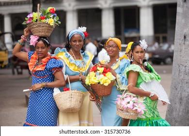 HAVANA, CUBA, FEBRUARY 15, 2013 : Colorful cubes women in national costumes of Cuba