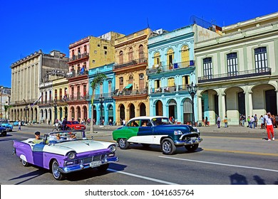 HAVANA, CUBA - FEBRUARY 17, 2018 - Old buildings and classic cars on Paseo de Marti in the Habana Vieja (Old Havana) district, oposite the Capitolio Nacional buildings