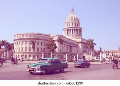 HAVANA, CUBA - FEBRUARY 26, 2011: Cubans drive Classic American cars on February 26, 2011 in Havana. Recent change in law allows the Cubans to trade cars after it was forbidden for many years.