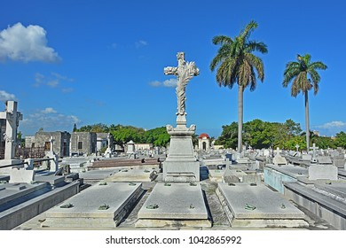 HAVANA, CUBA - FEBRUARY 27, 2018 -Decorated cross on a grave on Colon Cemetery (Columbus cemetery)