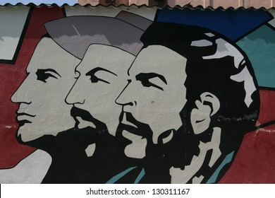 HAVANA - CUBA JAN 22: A grunge graffiti portrait of Che Guevara and Fidel Castro on a wall January 22 2008 in Havana, Cuba. Guevara is considered to be an iconic symbol of revolution worldwide.