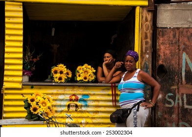 HAVANA, CUBA - JANUARY 1, 2014: Two Cuban women at a small floral shop in Old Havana, Havana, Cuba. Old Havana is city-center and one of the 15 municipalities forming Havana, Cuba