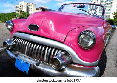 HAVANA, CUBA - JANUARY 10, 2014: A 1950´s car in the Revolution square symbol from the isolation that suffers Cuba from 1959 since Fidel Castro took power