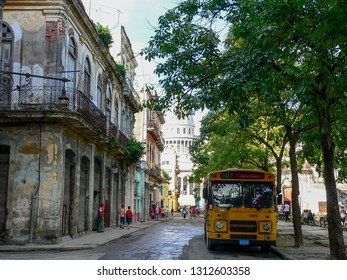 Havana, Cuba - January 11, 2009: Old yellow Dutch bus with the sign 'out of order' in the streets of Havana city with the Capitol building in the background