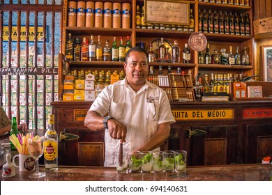 HAVANA, CUBA - JANUARY 14, 2016: Waiter preparing mojitos in the bar of the Bodeguita del Medio, in the historic center of the city